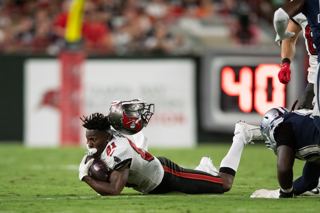 Sep 9, 2021; Tampa, Florida, USA; Tampa Bay Buccaneers wide receiver Antonio Brown (81) loses his helmet as he makes a catch against the Dallas Cowboys in the fourth quarter at Raymond James Stadium. Mandatory Credit: Jeremy Reper-USA TODAY Sports