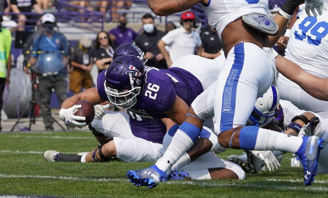 Sep 11, 2021; Evanston, Illinois, USA; Northwestern Wildcats running back Evan Hull (26) scores a touchdown against the Indiana State Sycamores during the first half at Ryan Field. Mandatory Credit: David Banks-USA TODAY Sports