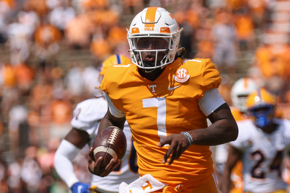 Sep 11, 2021; Knoxville, Tennessee, USA; Tennessee Volunteers quarterback Joe Milton III (7) runs the ball against the Pittsburgh Panthers during the second quarter at Neyland Stadium. Mandatory Credit: Randy Sartin-USA TODAY Sports