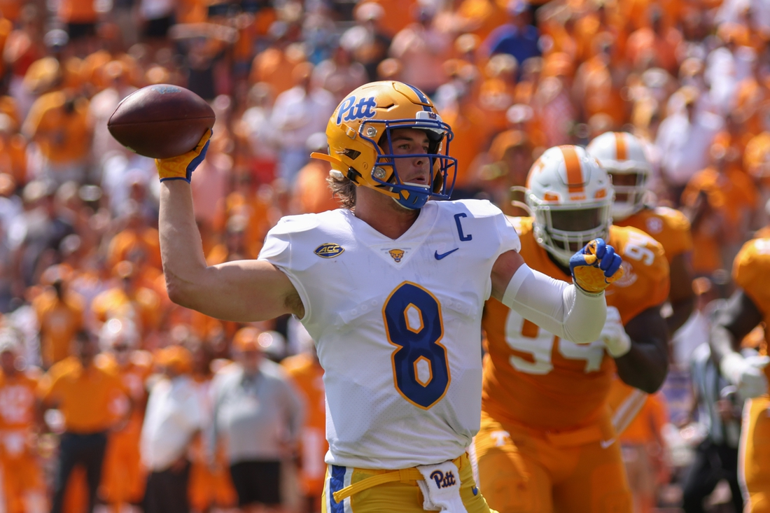 Sep 11, 2021; Knoxville, Tennessee, USA; Pittsburgh Panthers quarterback Kenny Pickett (8) throws a touchdown pass against the Tennessee Volunteers during the second quarter at Neyland Stadium. Mandatory Credit: Randy Sartin-USA TODAY Sports