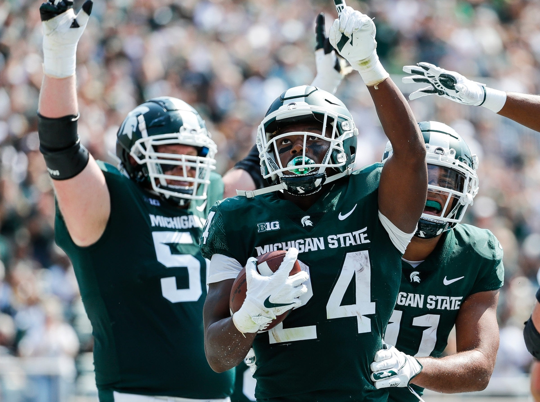 Michigan State running back Elijah Collins (24) celebrates a touchdown against Youngstown State during the first half at Spartan Stadium in East Lansing on Saturday, Sept. 11, 2021.