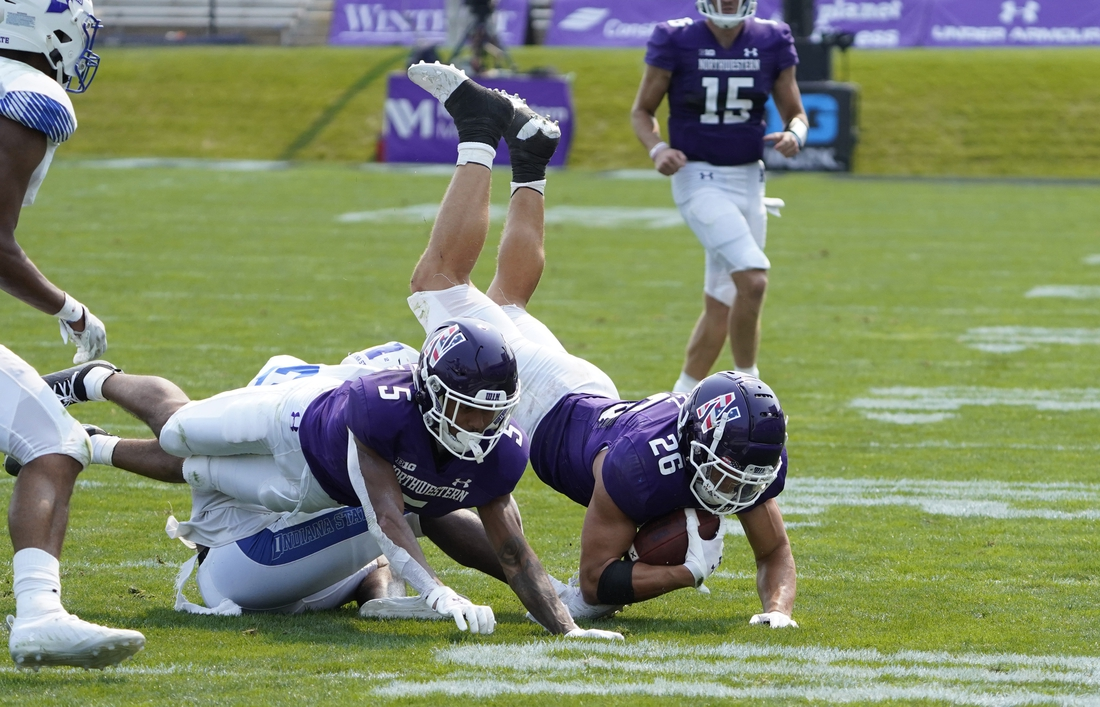 Sep 11, 2021; Evanston, Illinois, USA; Northwestern Wildcats running back Evan Hull (26) runs against the Indiana State Sycamores during the second half at Ryan Field. Mandatory Credit: David Banks-USA TODAY Sports