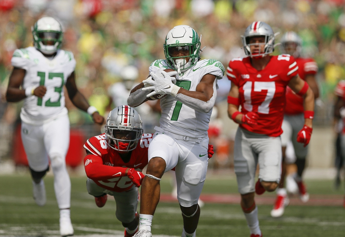 Oregon running back CJ Verdell runs past Ohio State  safety Bryson Shaw (17) and cornerback Cameron Brown (26) for a 77-yard touchdown on Saturday. Verdell scored two touchdowns.  Oregon CP