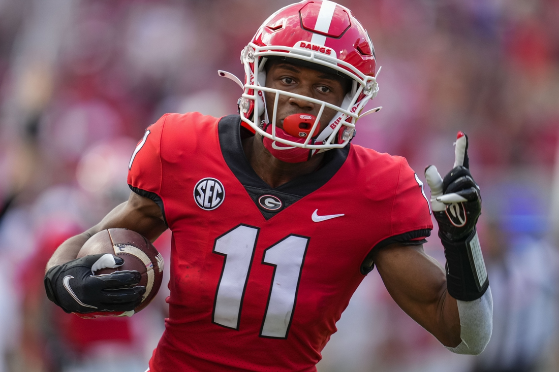 Sep 11, 2021; Athens, Georgia, USA; Georgia Bulldogs wide receiver Arian Smith (11) reacts as he scores a touchdown after catching a pass against the UAB Blazers during the first half at Sanford Stadium. Mandatory Credit: Dale Zanine-USA TODAY Sports