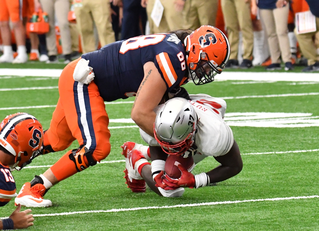 Sep 11, 2021; Syracuse, New York, USA; Rutgers Scarlet Knights defensive lineman CJ Onyechi (26) recovers a fumble as Syracuse Orange offensive lineman Airon Servais (68) tackles during the fourth quarter at the Carrier Dome. Mandatory Credit: Mark Konezny-USA TODAY Sports