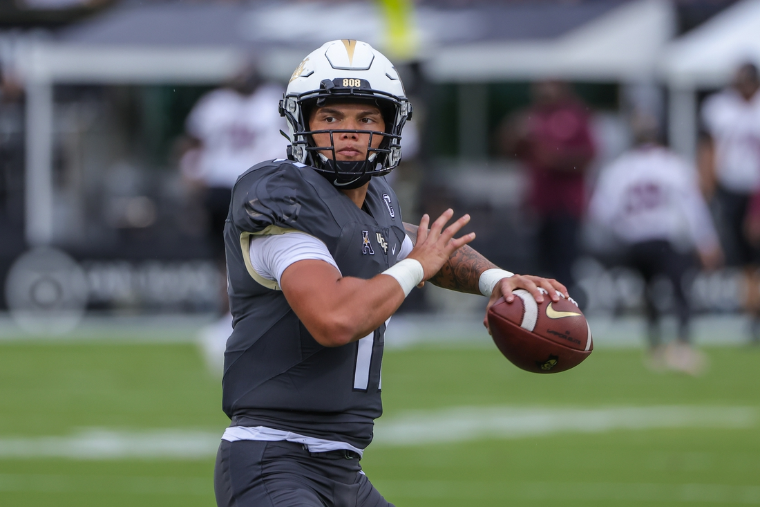 Sep 11, 2021; Orlando, Florida, USA; UCF Knights quarterback Dillon Gabriel (11) warms up before the game against the Bethune Cookman Wildcats at Bounce House. Mandatory Credit: Mike Watters-USA TODAY Sports
