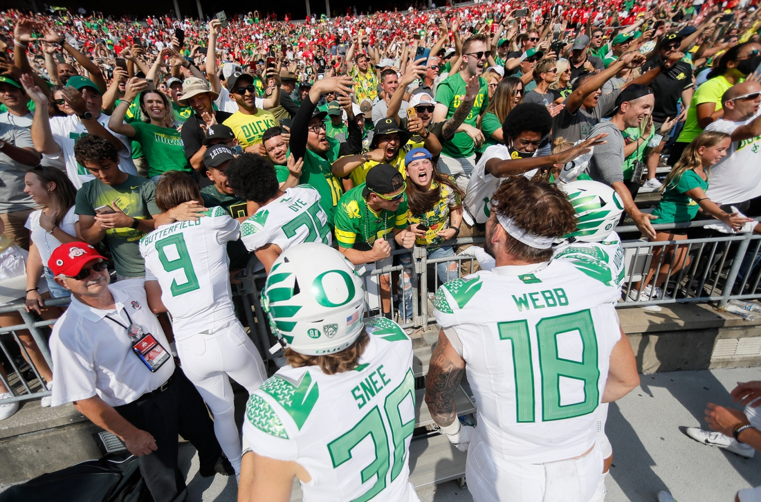 Oregon Ducks fans celebrate with players following their 35-28 win over the Ohio State Buckeyes in the NCAA football game at Ohio Stadium in Columbus on Saturday, Sept. 11, 2021.  Oregon Ducks At Ohio State Buckeyes Football