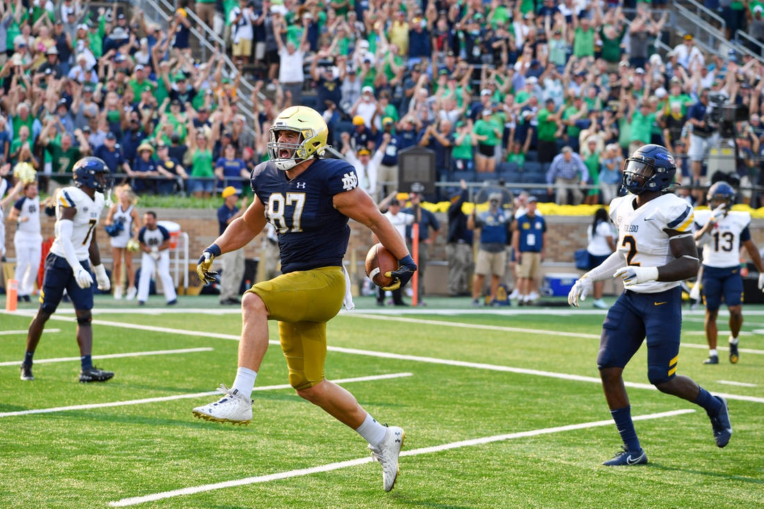Sep 11, 2021; South Bend, Indiana, USA; Notre Dame Fighting Irish tight end Michael Mayer (87) scores in the fourth quarter against the Toledo Rockets at Notre Dame Stadium. Mandatory Credit: Matt Cashore-USA TODAY Sports