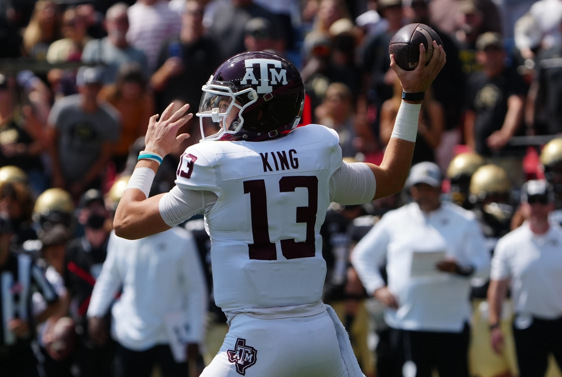 Sep 11, 2021; Denver, Colorado, USA; Texas A&M Aggies quarterback Haynes King (13) prepares to pass the ball in the first quarter against the Colorado Buffaloes at Empower Field at Mile High. Mandatory Credit: Ron Chenoy-USA TODAY Sports