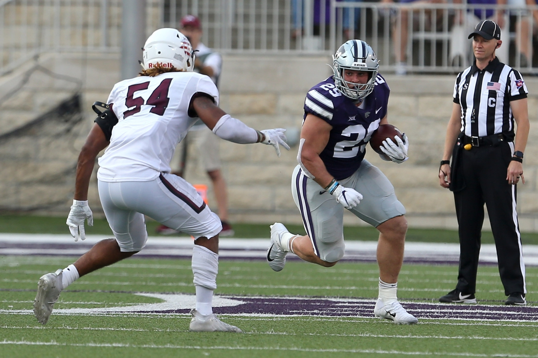 Sep 11, 2021; Manhattan, Kansas, USA; Kansas State Wildcats fullback Jax Dineen (29) looks for room to run against Southern Illinois Salukis linebacker Bryce Notree (54) during a game at Bill Snyder Family Football Stadium. Mandatory Credit: Scott Sewell-USA TODAY Sports