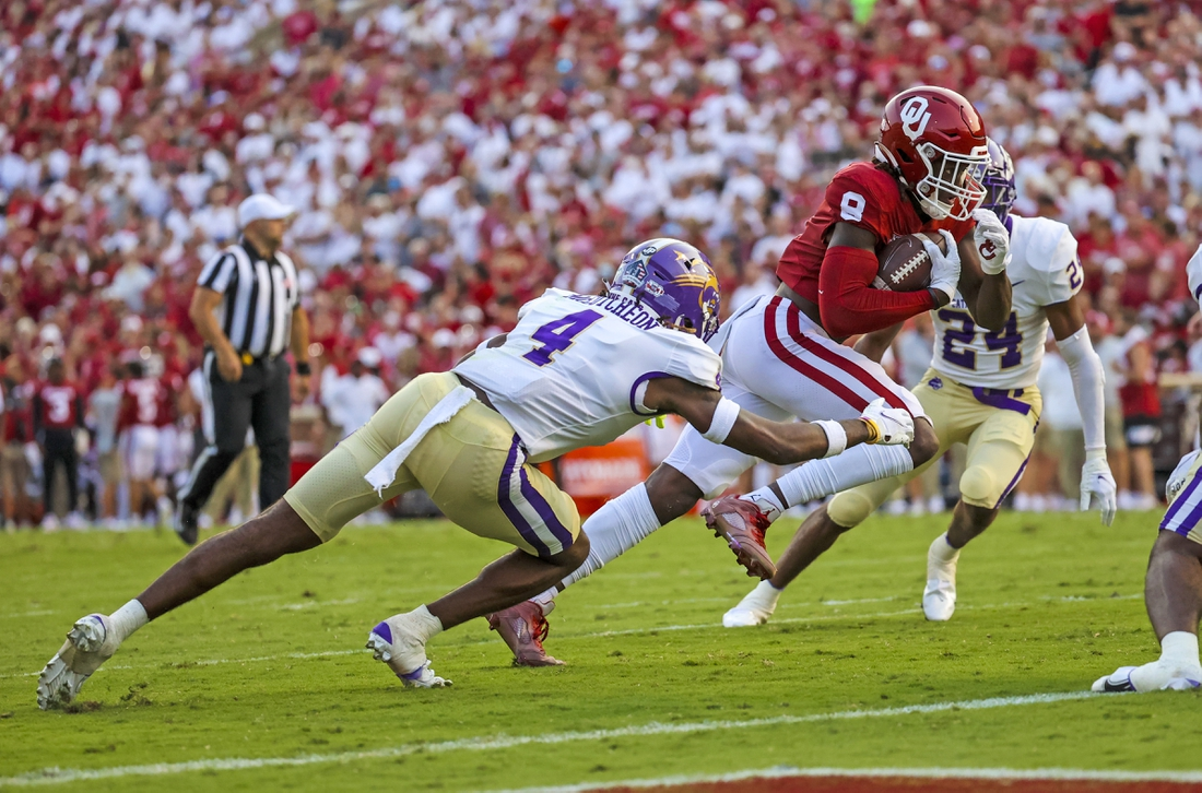 Sep 11, 2021; Norman, Oklahoma, USA; Oklahoma Sooners wide receiver Michael Woods II (8) scores a touchdown past Western Carolina Catamounts defensive back Cameron McCutcheon (4) during the second quarter at Gaylord Family-Oklahoma Memorial Stadium. Mandatory Credit: Kevin Jairaj-USA TODAY Sports