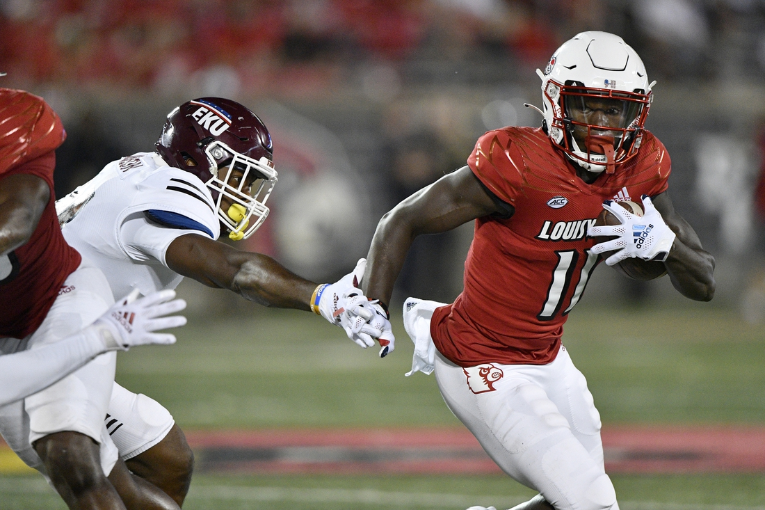 Sep 11, 2021; Louisville, Kentucky, USA;  Louisville Cardinals wide receiver Josh Johnson (11) runs the ball past the reach of Eastern Kentucky Colonels linebacker Je'Vari Anderson (14) during the second quarter at Cardinal Stadium. Mandatory Credit: Jamie Rhodes-USA TODAY Sports