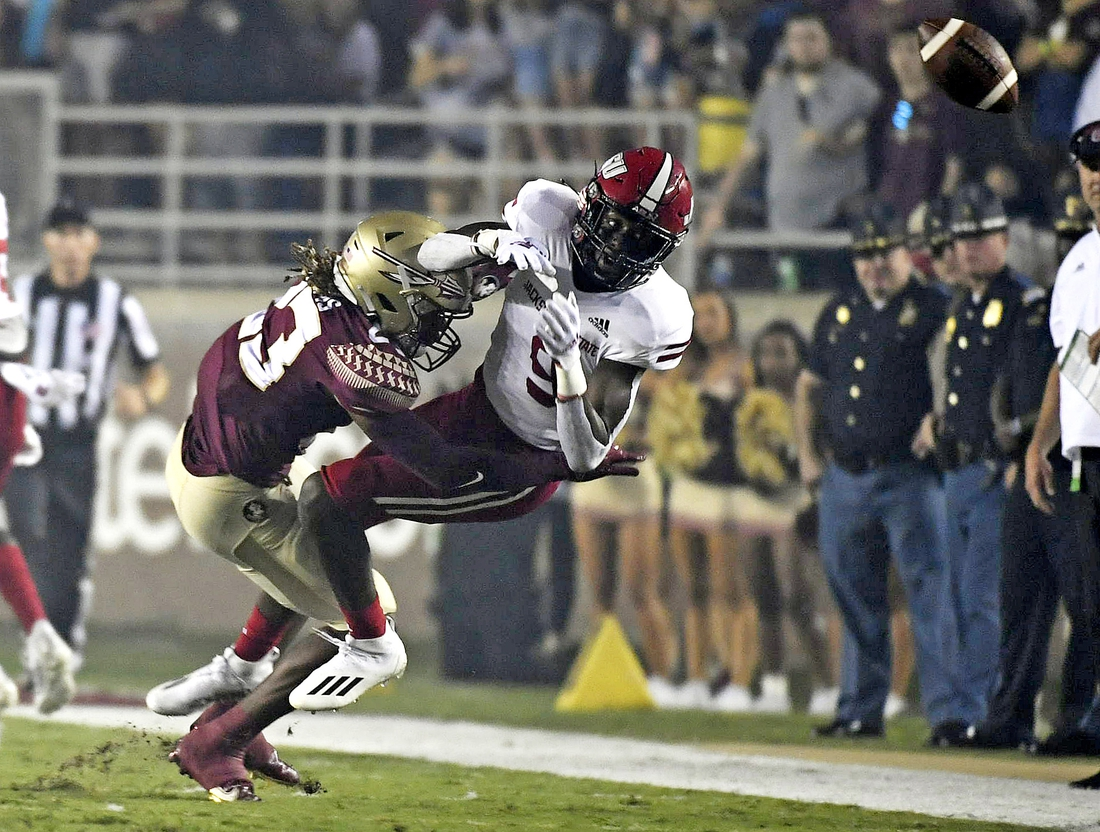 Sep 11, 2021; Tallahassee, Florida, USA; Florida State Seminoles defensive back Sidney Wiliams (23) knocks the ball loose from Jacksonville State Gamecocks wide receiver Ahmad Edwards (9) during the first quarter at Doak S. Campbell Stadium. Mandatory Credit: Melina Myers-USA TODAY Sports