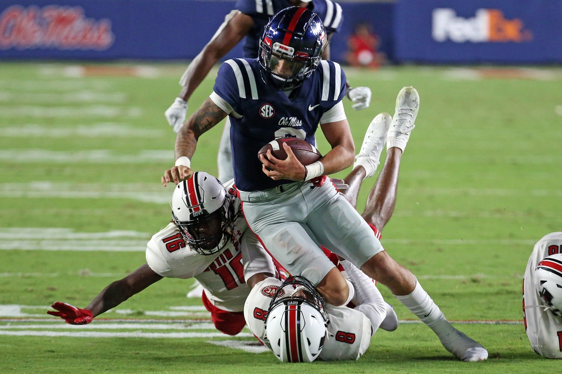 Sep 11, 2021; Oxford, Mississippi, USA; Mississippi Rebels quarterback Matt Corral (2) runs the ball against Austin Peay Governors defensive back Shamari Simmons (16) and defensive back Isaiah Norman (8) during the second quarter at Vaught-Hemingway Stadium. Mandatory Credit: Petre Thomas-USA TODAY Sports