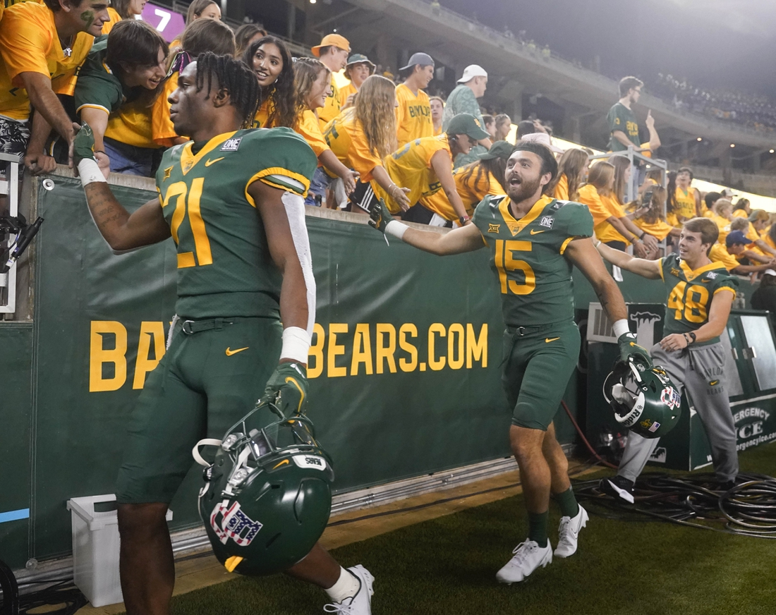 Sep 11, 2021; Waco, Texas, USA; Baylor Bears players greet fans along the sidelines after a victory over the Texas Southern Tigers at McLane Stadium. Mandatory Credit: Scott Wachter-USA TODAY Sports