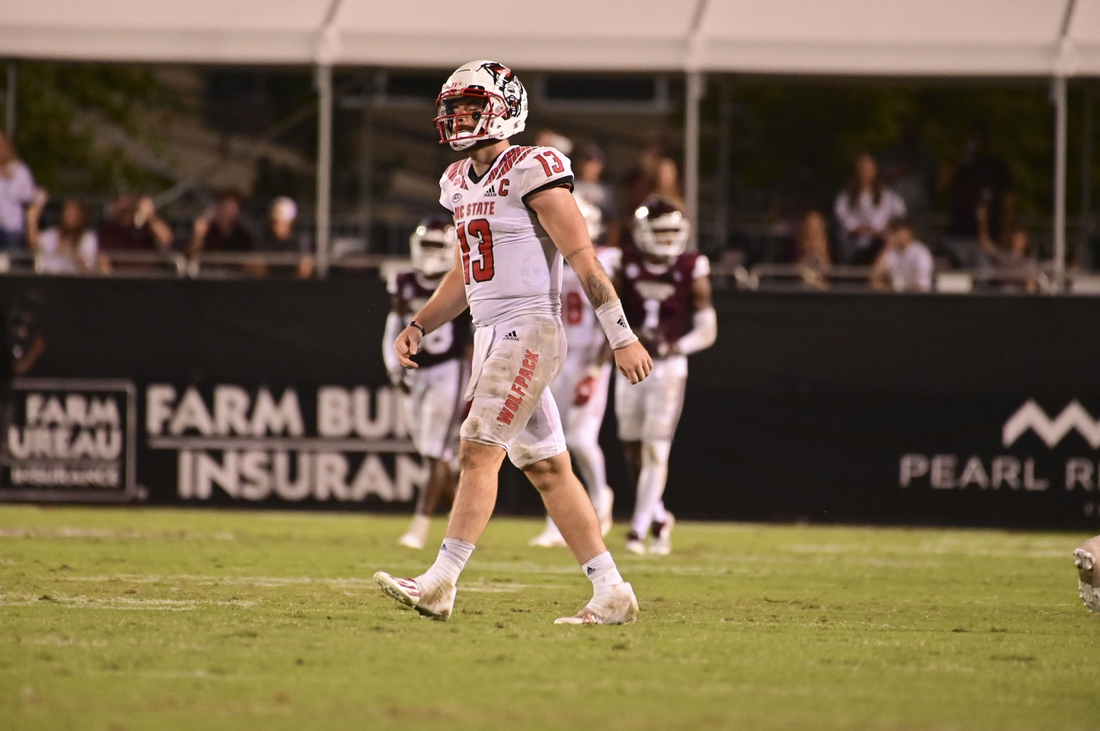 Sep 11, 2021; Starkville, Mississippi, USA; North Carolina State Wolfpack quarterback Devin Leary (13) reacts during the fourth quarter against the Mississippi State Bulldogs at Davis Wade Stadium at Scott Field. Mandatory Credit: Matt Bush-USA TODAY Sports