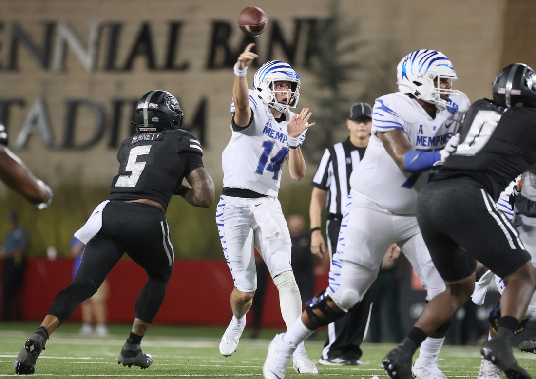 Memphis Tigers quarterback Seth Henigan throws the ball against the Arkansas State Red Wolves during their game at Centennial Bank Stadium in Jonesboro, Ark. On Sept. 11, 2021.  Jrca1930
