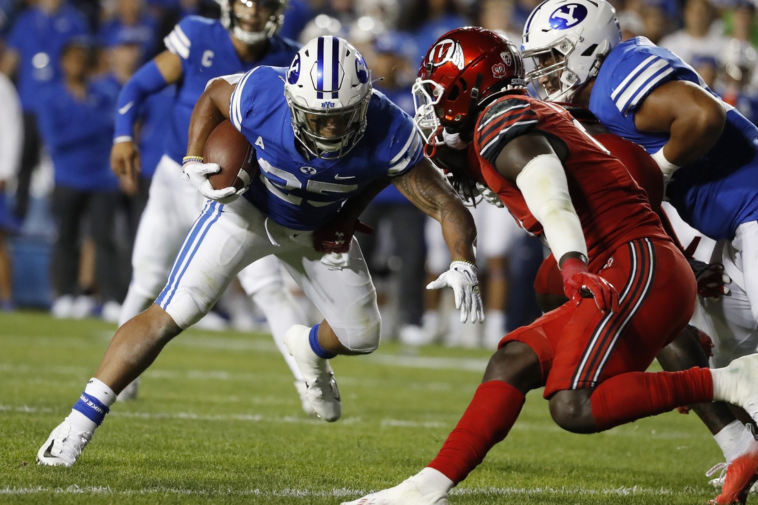 Sep 11, 2021; Provo, Utah, USA; Brigham Young Cougars running back Tyler Allgeier (25) runs the ball in the second quarter against the Utah Utes at LaVell Edwards Stadium. Mandatory Credit: Jeffrey Swinger-USA TODAY Sports