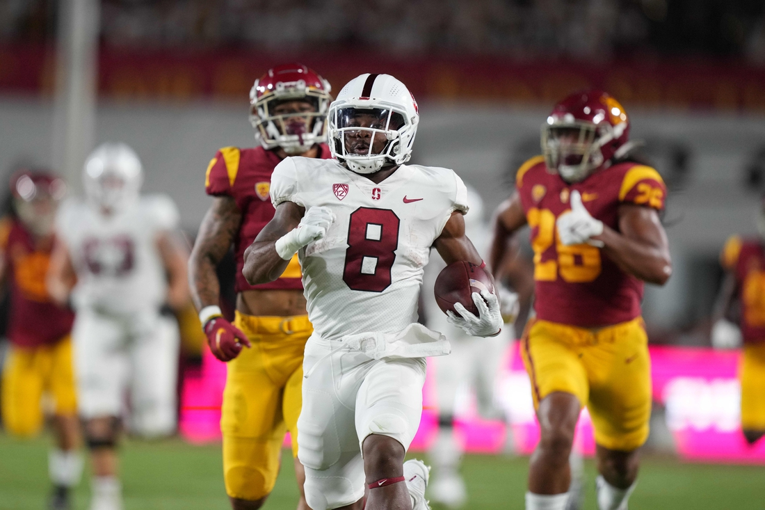 Sep 11, 2021; Los Angeles, California, USA; Stanford Cardinal running back Nathaniel Peat (8) scores on an 87-yard touchdown run against the Southern California Trojans in the first quarter at United Airlines Field at Los Angeles Memorial Coliseum. Mandatory Credit: Kirby Lee-USA TODAY Sports
