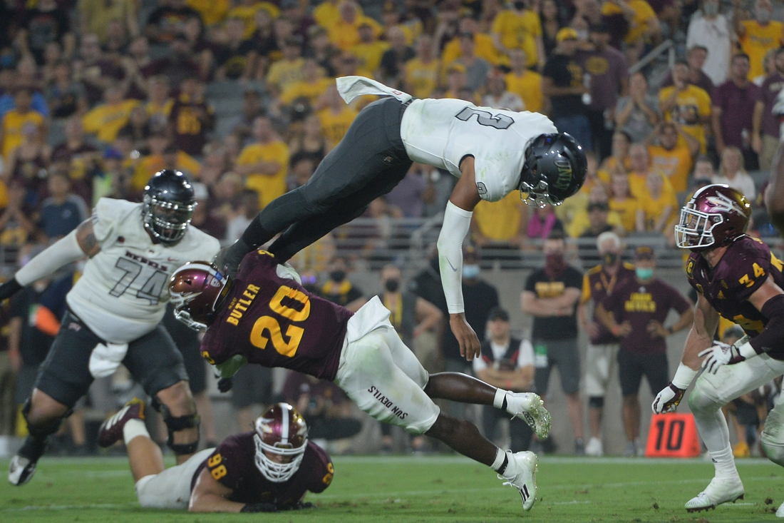 Sep 11, 2021; Tempe, Arizona, USA; UNLV Rebels quarterback Doug Brumfield (2) dives for a touchdown against the Arizona State Sun Devils during the first half at Sun Devil Stadium. Mandatory Credit: Joe Camporeale-USA TODAY Sports