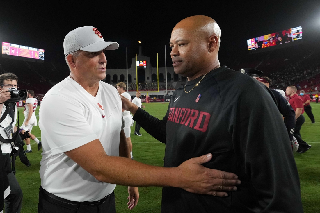 Sep 11, 2021; Los Angeles, California, USA; Southern California Trojans head coach Clay Helton and Stanford Cardinal head coach David Shaw shake hands after a game at United Airlines Field at Los Angeles Memorial Coliseum. Mandatory Credit: Kirby Lee-USA TODAY Sports