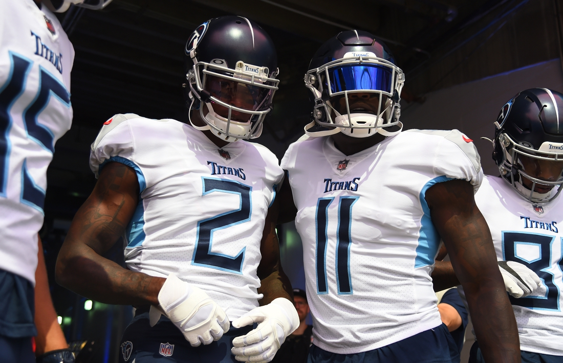 Sep 12, 2021; Nashville, Tennessee, USA; Tennessee Titans wide receiver Julio Jones (2) and Tennessee Titans wide receiver A.J. Brown (11) before the game against the Arizona Cardinals at Nissan Stadium. Mandatory Credit: Christopher Hanewinckel-USA TODAY Sports