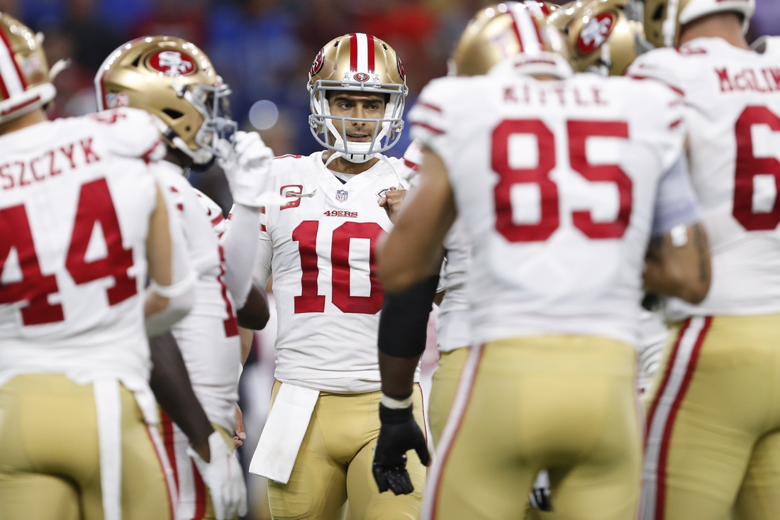 Sep 12, 2021; Detroit, Michigan, USA; San Francisco 49ers quarterback Jimmy Garoppolo (10) huddles with teammates during the first quarter against the Detroit Lions at Ford Field. Mandatory Credit: Raj Mehta-USA TODAY Sports