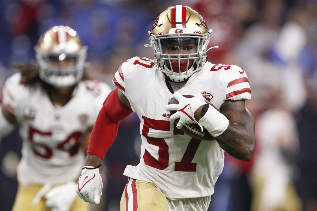 Sep 12, 2021; Detroit, Michigan, USA; San Francisco 49ers linebacker Dre Greenlaw (57) runs after an interception during the second quarter against the Detroit Lions at Ford Field. Mandatory Credit: Raj Mehta-USA TODAY Sports