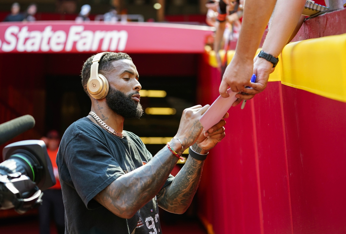Sep 12, 2021; Kansas City, Missouri, USA; Cleveland Browns wide receiver Odell Beckham Jr. (13) signs autographs before the game against the Kansas City Chiefs at GEHA Field at Arrowhead Stadium. Mandatory Credit: Jay Biggerstaff-USA TODAY Sports