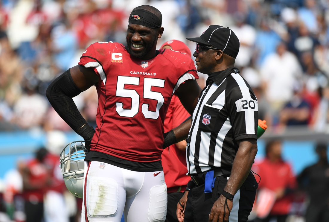Sep 12, 2021; Nashville, Tennessee, USA; Arizona Cardinals defensive end Chandler Jones (55) talks with umpire Barry Anderson (20) during the second half against the Tennessee Titans at Nissan Stadium. Mandatory Credit: Christopher Hanewinckel-USA TODAY Sports