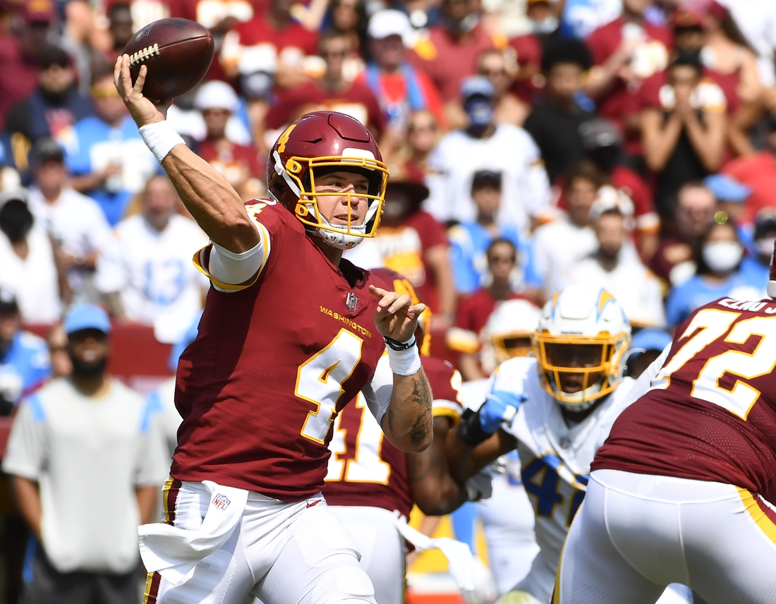 Sep 12, 2021; Landover, Maryland, USA; Washington Football Team quarterback Taylor Heinicke (4) attempts a pass against the Los Angeles Chargers during the second quarter at FedExField. Mandatory Credit: Brad Mills-USA TODAY Sports