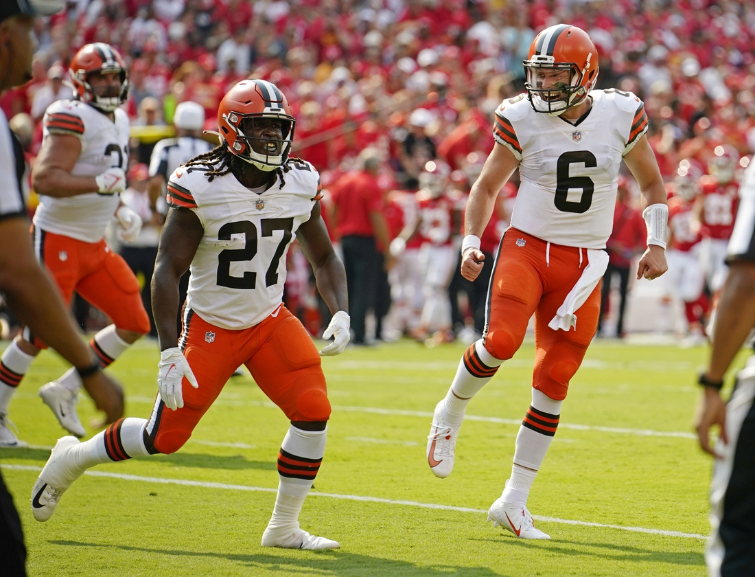 Sep 12, 2021; Kansas City, Missouri, USA; Cleveland Browns running back Kareem Hunt (27) and quarterback Baker Mayfield (6) celebrate after a successful two point conversion against the Kansas City Chiefs during the first half at GEHA Field at Arrowhead Stadium. Mandatory Credit: Jay Biggerstaff-USA TODAY Sports