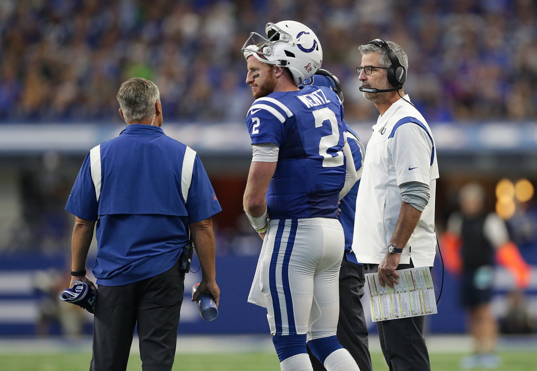 Indianapolis Colts head coach Frank Reich (right) talks with quarterback Carson Wentz (2) on Sunday, Sept. 12, 2021, at Lucas Oil Stadium and Indianapolis. The Seahawks defeated the Colts, 28-16.Indianapolis Colts And Seattle Seahawks On Nfl Week 1 At Lucas Oil Stadium Sunday Sept 12 2021