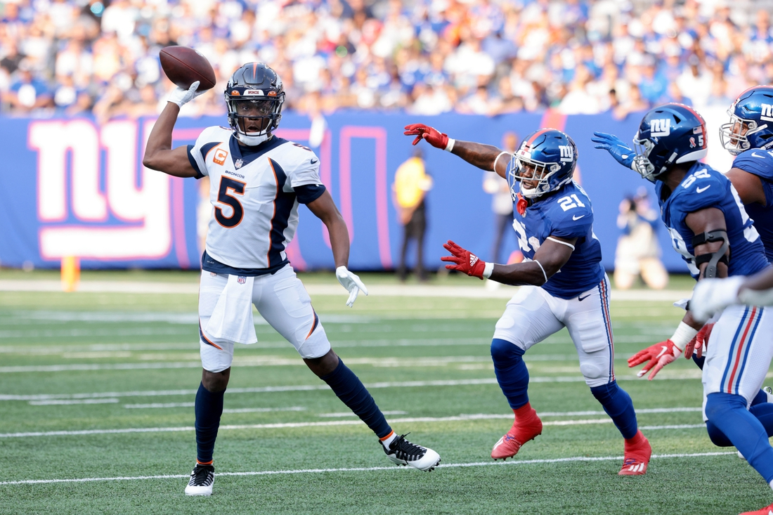 Sep 12, 2021; East Rutherford, New Jersey, USA; Denver Broncos quarterback Teddy Bridgewater (5) throws the ball against the New York Giants during the first quarter at MetLife Stadium. Mandatory Credit: Vincent Carchietta-USA TODAY Sports