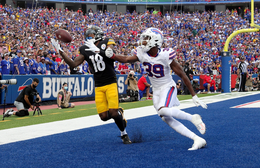Steelers receiver Diontae Johnson holds onto this pass in the end zone against Bills cornerback Levi Wallace.  Pittsburgh went on to win 23-16.  Jg 091221 Bills 2b
