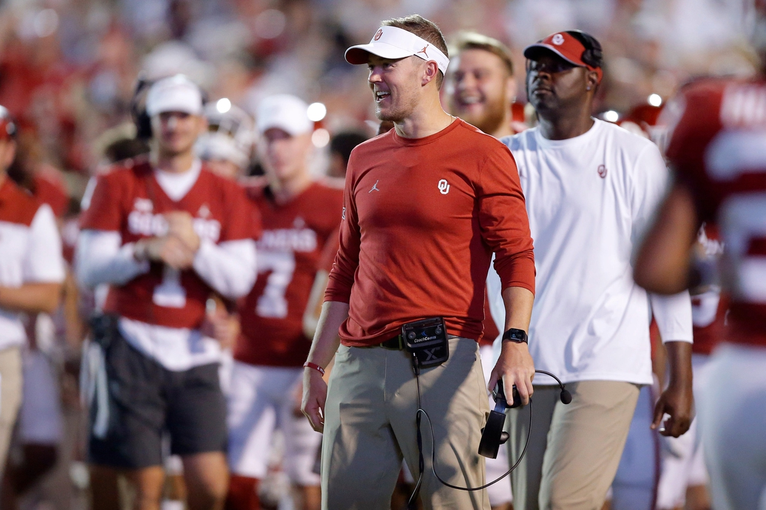 OU coach Lincoln Riley smiles after a touchdown Saturday night.  jump