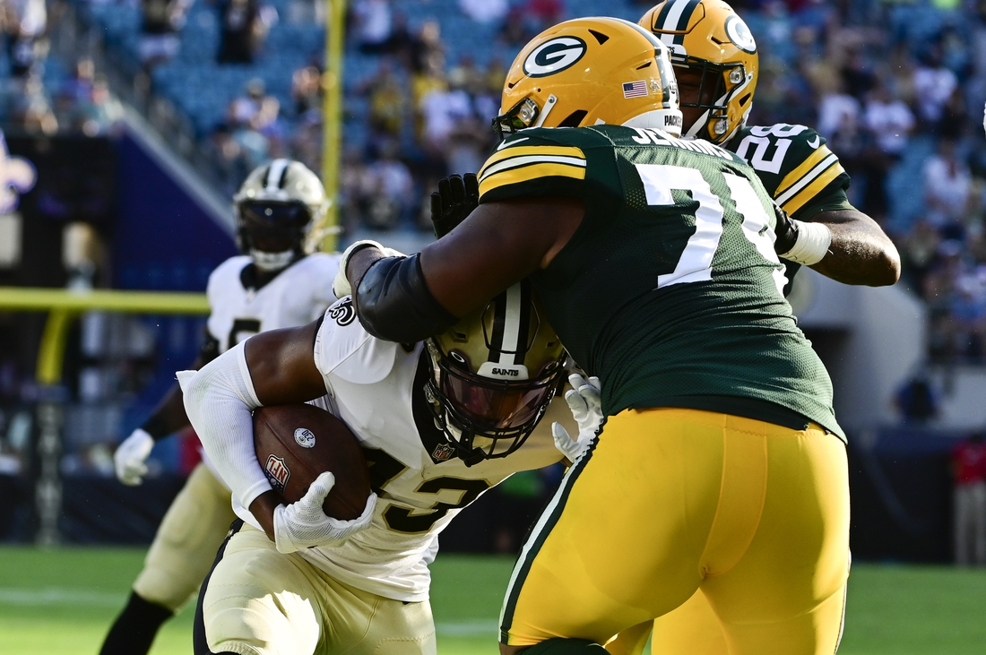 Sep 12, 2021; Jacksonville, Florida, USA;  Green Bay Packers guard Elgton Jenkins (74) tackles New Orleans Saints safety Marcus Williams (43) along the sideline during the third quarter at TIAA Bank Field. Mandatory Credit: Tommy Gilligan-USA TODAY Sports