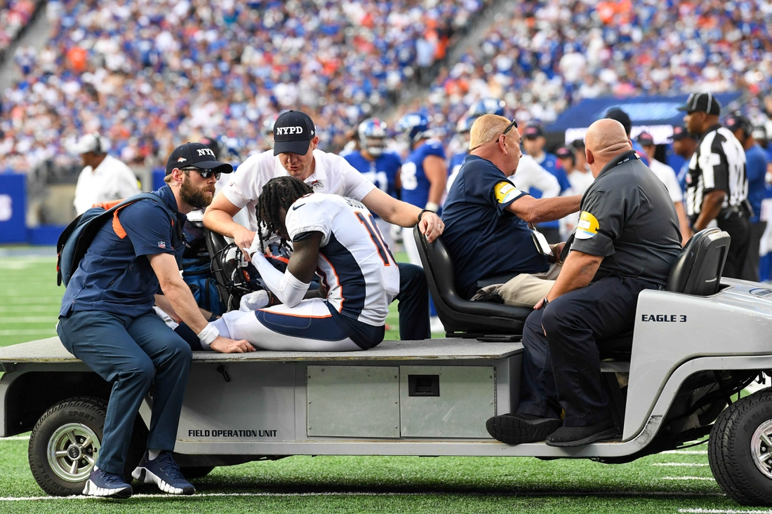 Sep 12, 2021; East Rutherford, New Jersey, USA;  Denver Broncos wide receiver Jerry Jeudy (10) is taken off the field after being injured in the game against the New York Giants during the second half at MetLife Stadium. Mandatory Credit: Dennis Schneidler-USA TODAY Sports