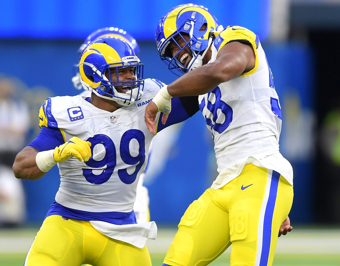 Sep 12, 2021; Inglewood, California, USA;  Los Angeles Rams defensive end Aaron Donald (99) celebrates with linebacker Justin Hollins (58) after he forced a fumble against the Chicago Bears in the first half of the game at SoFi Stadium. Mandatory Credit: Jayne Kamin-Oncea-USA TODAY Sports