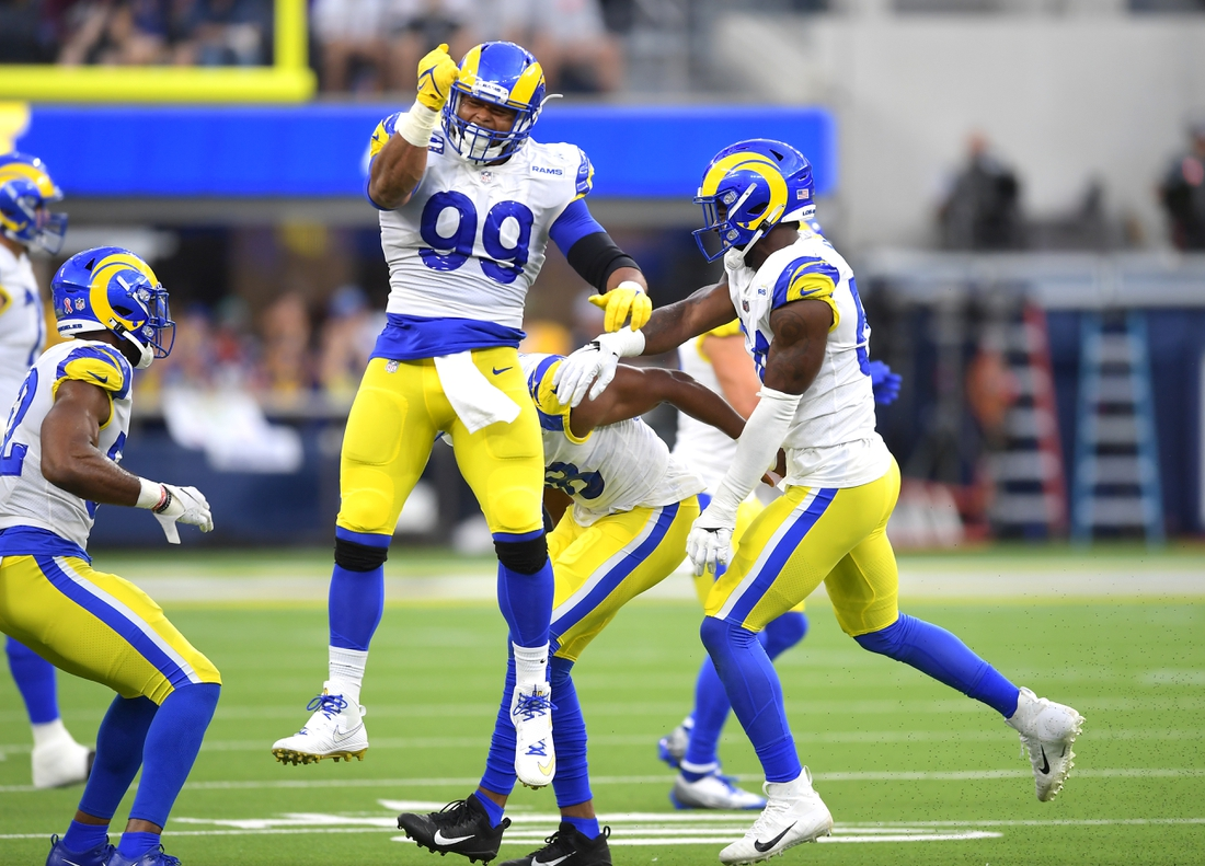 Sep 12, 2021; Inglewood, California, USA;  Los Angeles Rams defensive end Aaron Donald (99) celebrates after a fumble against the Chicago Bears in the first half of the game at SoFi Stadium. Mandatory Credit: Jayne Kamin-Oncea-USA TODAY Sports