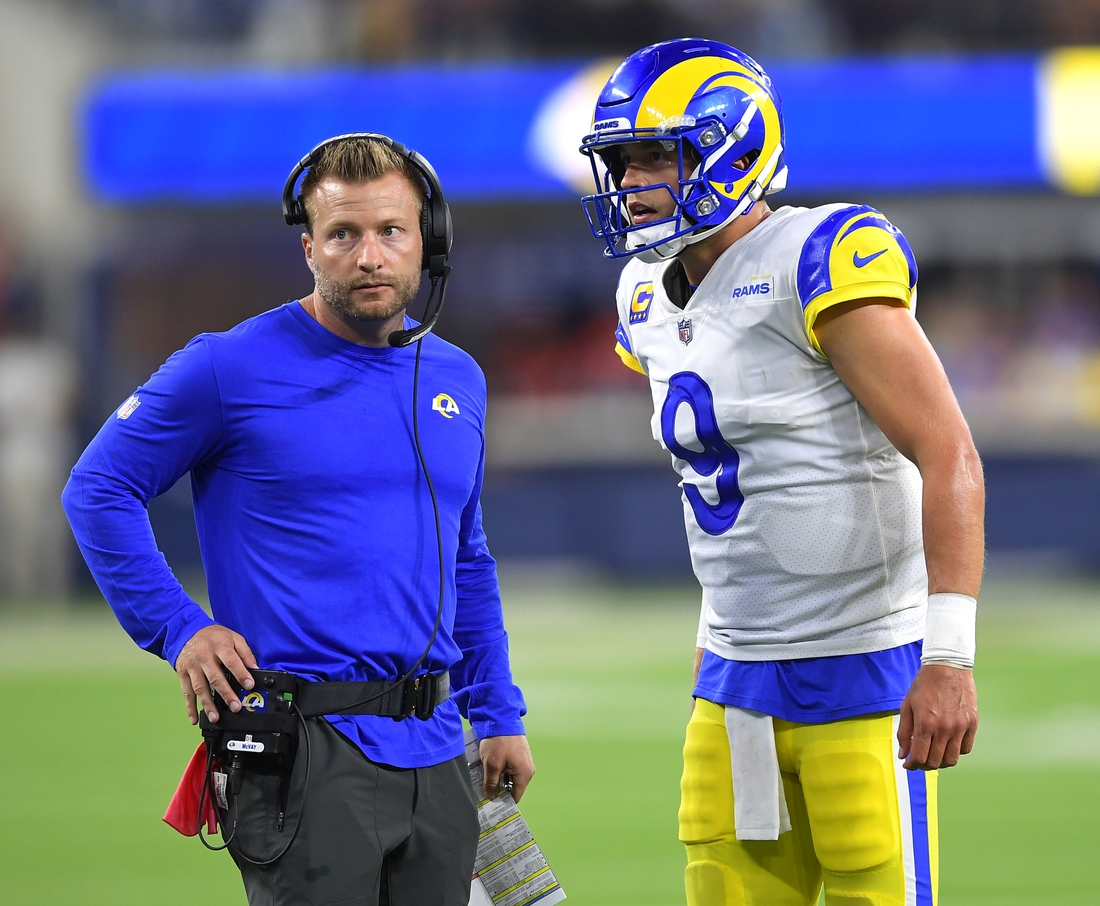 Sep 12, 2021; Inglewood, California, USA; Los Angeles Rams head coach Sean McVay talks with quarterback Matthew Stafford (9) during a time out in the fourth quarter of the game against the Chicago Bears at SoFi Stadium. Mandatory Credit: Jayne Kamin-Oncea-USA TODAY Sports
