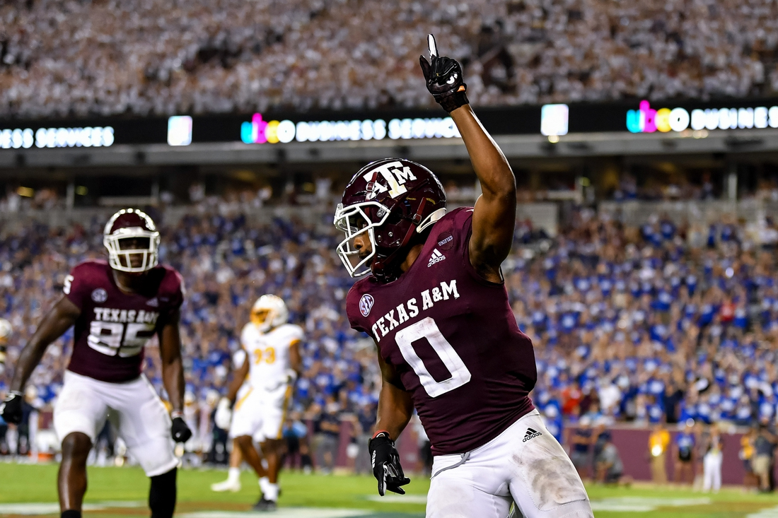 Sep 4, 2021;  College Station, Texas, USA;  Texas A&M Aggies wide receiver Ainias Smith (0) reacts after his touchdown in the fourth quarter against the Kent State Golden Flashes at Kyle Field. Mandatory Credit: Maria Lysaker-USA TODAY Sports