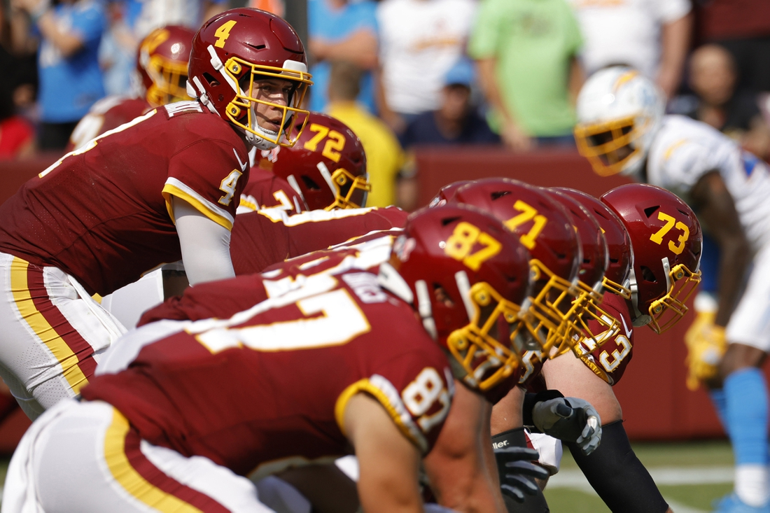 Sep 12, 2021; Landover, Maryland, USA; Washington Football Team quarterback Taylor Heinicke (4) lines up under center Washington Football Team center Chase Roullier (73) against the Los Angeles Chargers at FedExField. Mandatory Credit: Geoff Burke-USA TODAY Sports