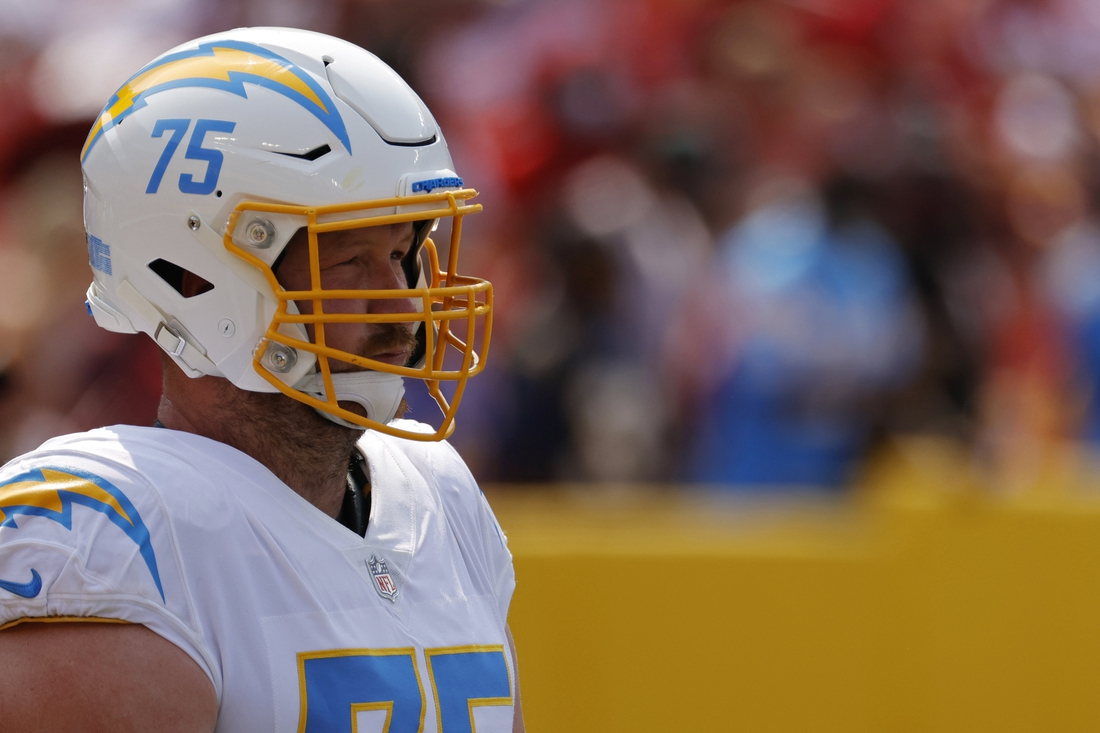Sep 12, 2021; Landover, Maryland, USA; Los Angeles Chargers offensive tackle Bryan Bulaga (75) stands on the field during warmups prior to the Chargers' game against the Washington Football Team at FedExField. Mandatory Credit: Geoff Burke-USA TODAY Sports