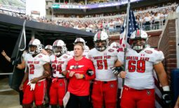 Sep 11, 2021; Oxford, Mississippi, USA; Austin Peay Governors head coach Scotty Walden (middle), offensive linemen Garrett Bell (57), wide receiver Trey Goodman (24), offensive linemen Colby McKee (51) and offensive linemen Michael Treadwell (69) prepare to run out of the tunnel before their game against the Mississippi Rebels at Vaught-Hemingway Stadium. Mandatory Credit: Petre Thomas-USA TODAY Sports