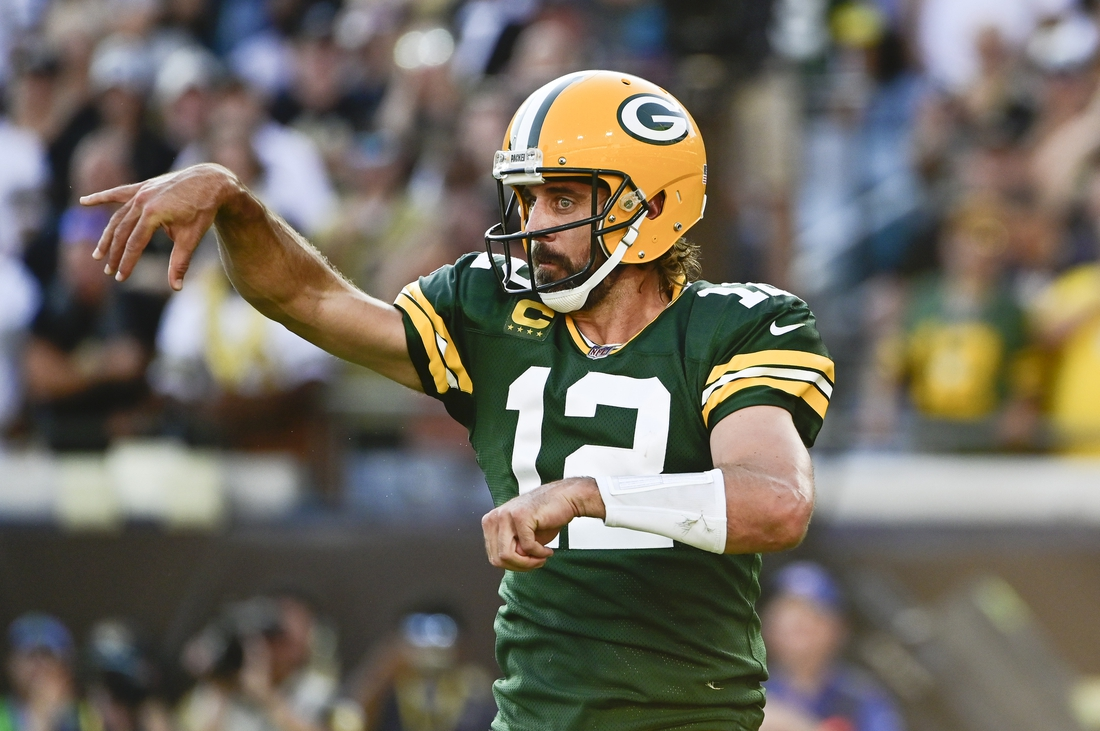 Sep 12, 2021; Jacksonville, Florida, USA; Green Bay Packers quarterback Aaron Rodgers (12) throws against the New Orleans Saints during the first half  at TIAA Bank Field. Mandatory Credit: Tommy Gilligan-USA TODAY Sports
