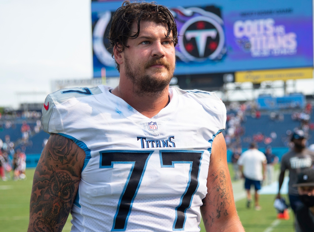 Tennessee Titans offensive tackle Taylor Lewan (77) walks off the field after their 38 to 13 loss against the Arizona Cardinals at Nissan Stadium Sunday, Sept. 12, 2021 in Nashville, Tenn.  Nas Titans Cardinals 026