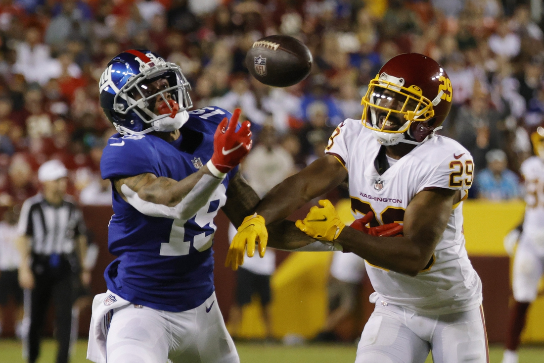 Sep 16, 2021; Landover, Maryland, USA; New York Giants wide receiver Kenny Golladay (19) attempts to make a catch as Washington Football Team cornerback Kendall Fuller (29) defends in the third quarter at FedExField. Mandatory Credit: Geoff Burke-USA TODAY Sports