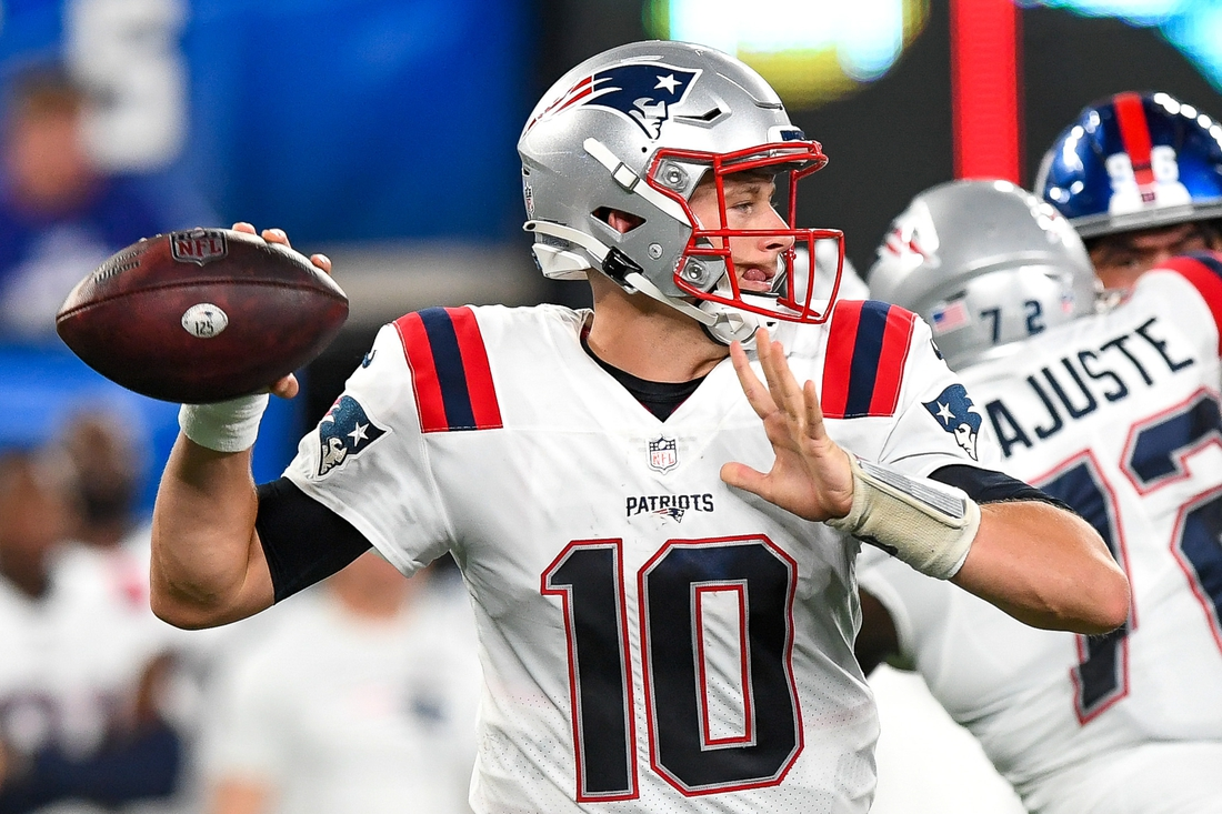 Aug 29, 2021; East Rutherford, New Jersey, USA; New England Patriots quarterback Mac Jones (10) attempts a pass against the New York Giants during the third quarter at MetLife Stadium. Mandatory Credit: Dennis Schneidler-USA TODAY Sports