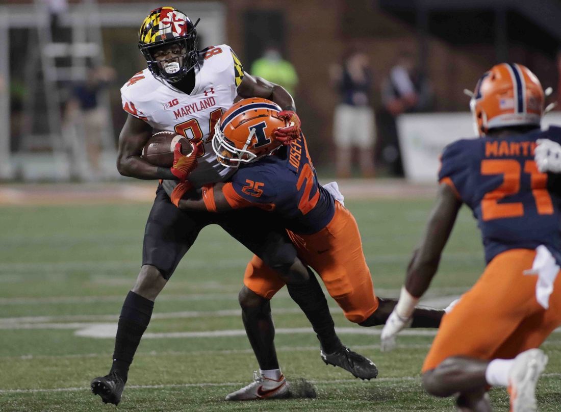 Sep 17, 2021; Champaign, Illinois, USA;  Illinois Fighting Illini defensive back Kerby Joseph (25) tackles Maryland Terrapins tight end Corey Dyches (84) in the first half at Memorial Stadium. Mandatory Credit: Ron Johnson-USA TODAY Sports